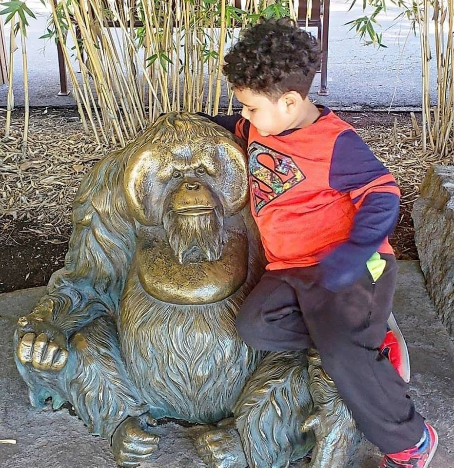 Alijah and a monkey statue